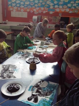 Students painting their favorite whales