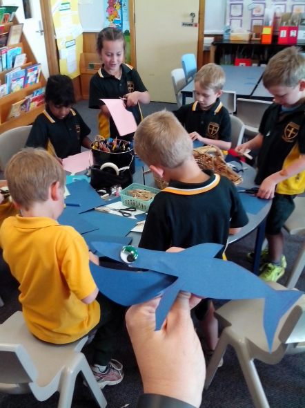 Students making clothespin whales